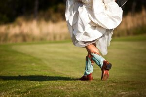 destination-bride-wears-wedding-dress-cowboy-boots.original